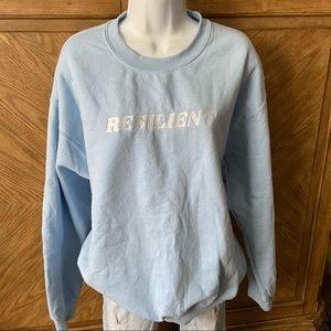 "Baby blue oversize graphic sweatshirt ""resilient"""